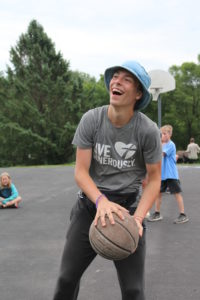Boy in Live Generously t-shirt with basketball